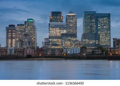 Office buildings in Canary Wharf, commercial, financial centre on the Isle of Dogs in London in the evening.