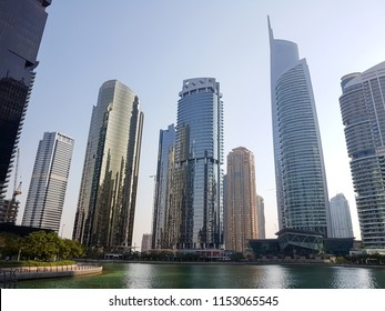 Office buildings with lake. Jumeirah Lake Towers, Dubai, UAE