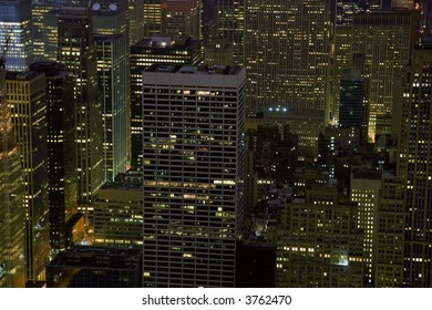 Office buildings at night in New York City.