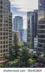 Office buildings overlook a rooftop gardens in downtown Vancouver British Columbia.