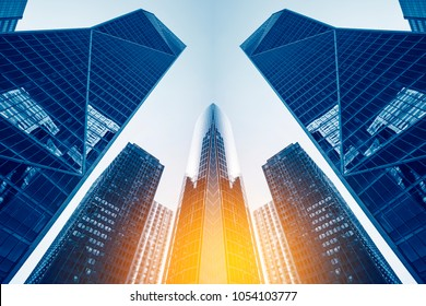 Office buildings in Paris business district La Defense. Skyscrapers glass facades. Modern urban architecture, economy, finances, business activity concept illustration. Abstract background.
