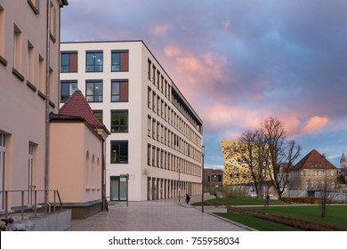 office buildings with sunset autumn colored sky and clouds in south germany historical city near munich and stuttgart
