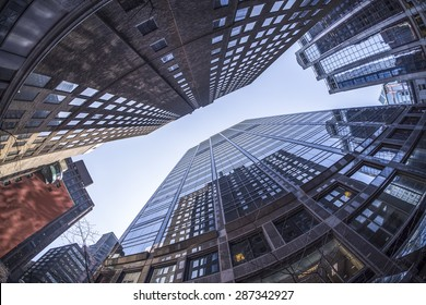 Office buildings in Toronto Ontario Canada appear to be falling towards each other. Photo taken with a fisheye lens.