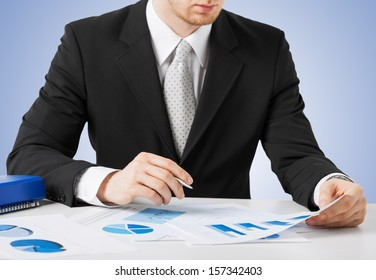office, buisness, legal concept - businessman working and signing with papers