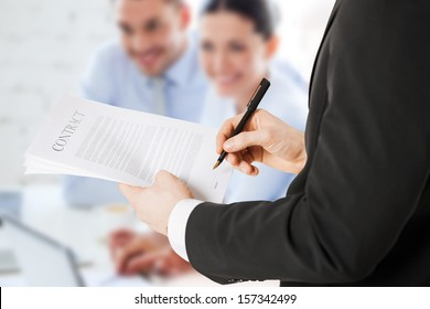 office, buisness, legal, teamwork concept - man signing contract