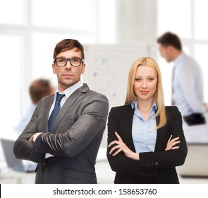 office, buisness, teamwork concept - businessman and businesswoman in the front of team