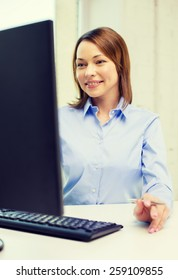 office, business, education, technology and internet concept - smiling businesswoman or student with computer
