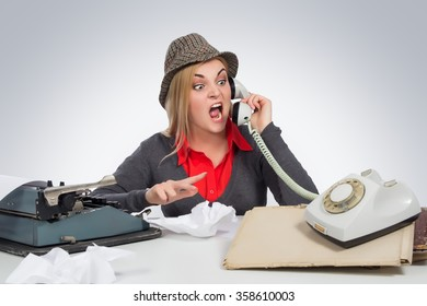 Office, business,detective concept-Angry Business Woman shouting into telephone on gray background