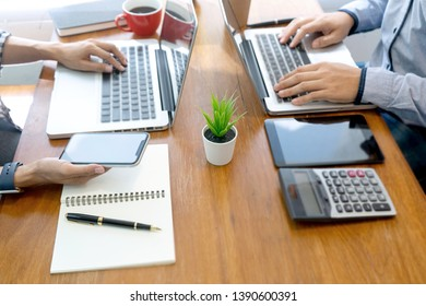 in office businessman business  work with friend on the table with computer laptop calulator ,working marketing plan data analyses.