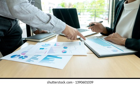 In office businessman in meeting analyses chart graphy marketing plan in business financial  audit project.