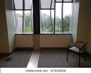 office chair with carpet and window and trees