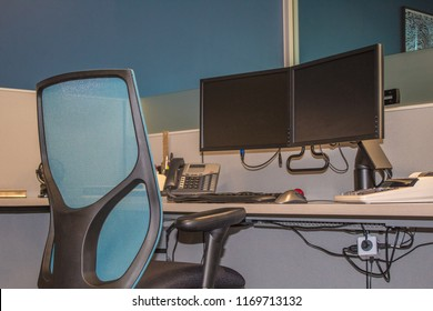 Office chair and double monitors on desk