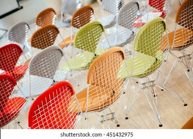Office chairs in different colors decrated with nets