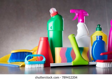 Office cleaning business. Cleaning products on gray tiles. Place for text.