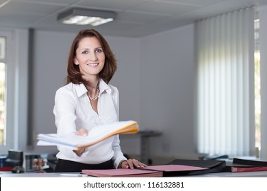 Office clerk delivers documents in the office