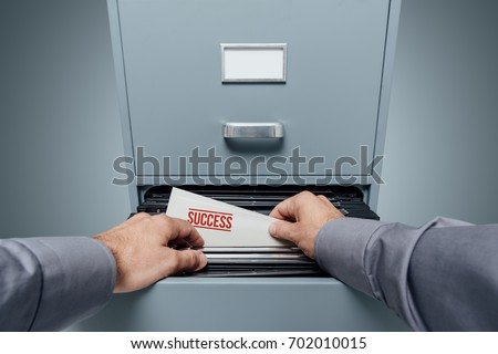 Office Clerk Searching Files Filing Cabinet Stock Photo Edit Now