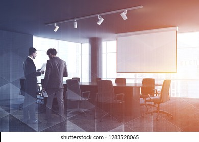 Office conference room interior with gray walls, panoramic windows, long table with beige chairs standing around it and big projector screen. Two businessmen talk. Toned iamge double exposure mock up