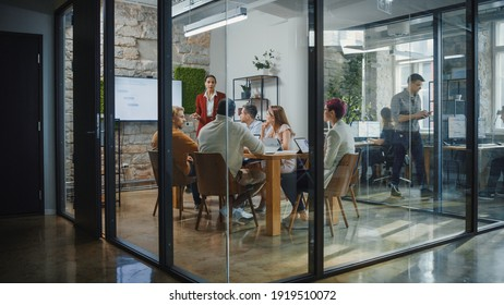 Office Conference Room Meeting: Female Chief Executive Talking to a Diverse Team of Professional Businesspeople. Creative People Listen to CEO Discuss Design, Data Analysis, Plan Marketing Strategy - Shutterstock ID 1919510072