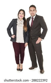 Office couple in formal clothes standing together looking at camera