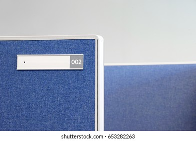office cubicle and nameplate