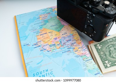 office decoration with laptop, money, compass and camera isolated white background, concept travel and insurance