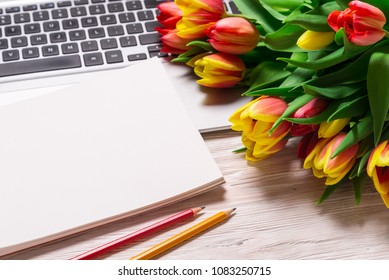 Office desk and bouquet of tulips