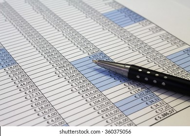 An office desk with charts and histograms graphical documents