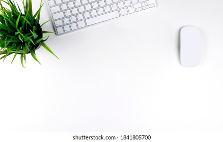 Office desk with copy space. Digital devices wireless keyboard and mouse on office table. Top view
