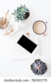 office desk flat lay with coffe, smartphone and succulents, clea
