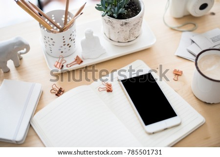 office desk flat lay with coffe, smartphone and succulents, styl
