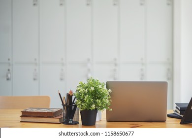 Office desk with laptop.