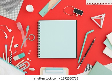Office desk with notebook mock up full of supplies. Creative flat lay.