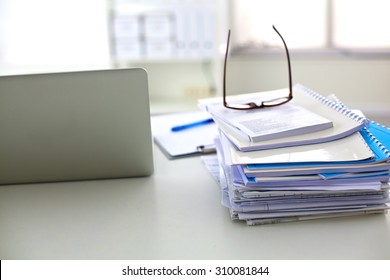 office desk a stack of computer paper reports work forms