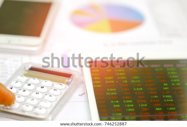 Office desk table with analysis chart or graph, pen and calculator. Top view with copy space.Working desk table concept.