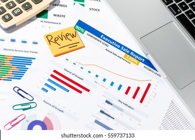 Office desk table with business paper, pen, office stationary, calculator, notebook, keyboard.  Top view with copy space. Useful for business, presentation, meeting, work, planning, sale