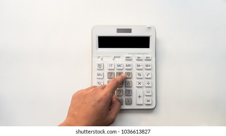 Office desk table with calculator Top view with hand on white background