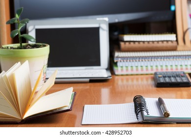 Office desk table with computer, calculator, supplies. Copy space for text.