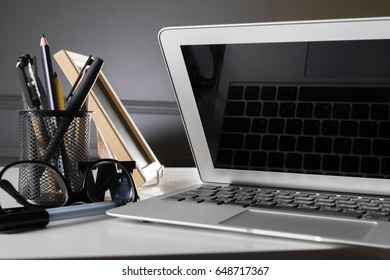 Office desk table with computer, supplies