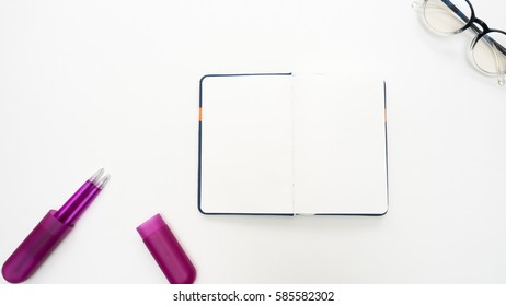 Office desk table with  pen and notebook close up Top view copy space