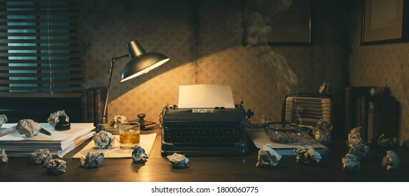 Office desk with vintage typewriter and crumpled paper balls, creative block concept, 1950s film noir style