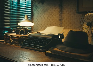 Office desk with vintage typewriter and fedora hat, 1950s film noir style
