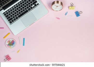 Office desk. Workspace with laptop, coffee cup, colorful clips and accessories. Flat lay, top view