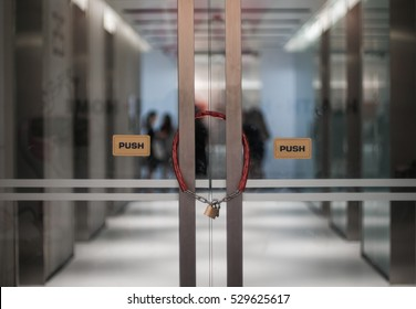 The office door locked with Metal chain and padlock