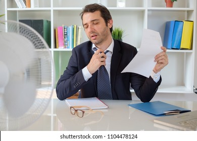 Office employee feeling stressed after summer heat haze
