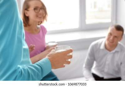 Office employees drinking water during break