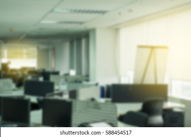 Office environment with light flare and soft focus.