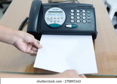Office fax machine with a business woman with print copy paper, hand woman are using a fax machine, printer scanner and copy to paper, photocopier or network printer is office