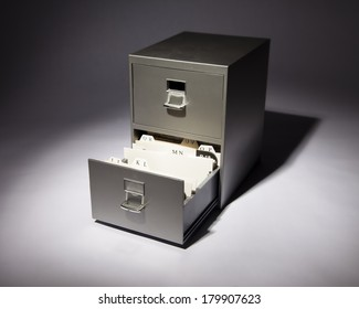 Good An Office Filing Cabinet In A Spotlight With Bottom Drawer Open.