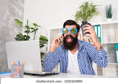 Office freak. Weirdo at workplace. Man freak crazy office manager having phone call while drinking coffee. Productive day. Freak managing projects. Emotional and mental composition of high performers.
