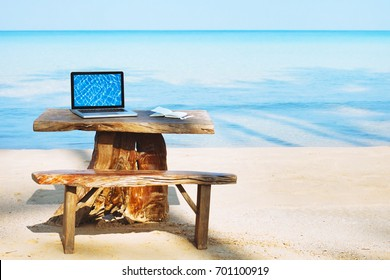 office of freelancer on the beach, laptop computer with empty screen and nobody, freelance concept